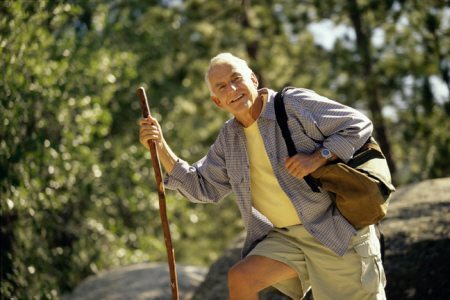 Image of man hiking using walking stick